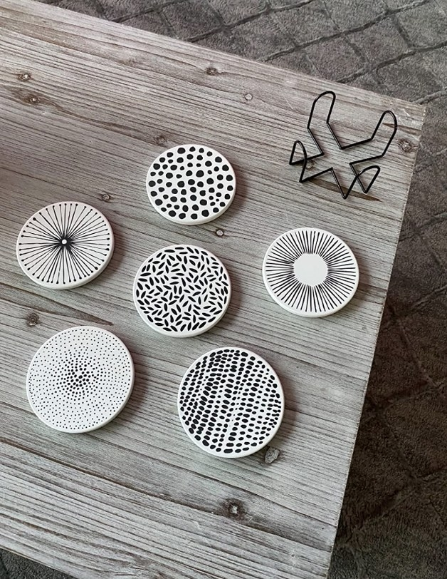 A set of six ceramic stone coasters with unique black/white patterns on each