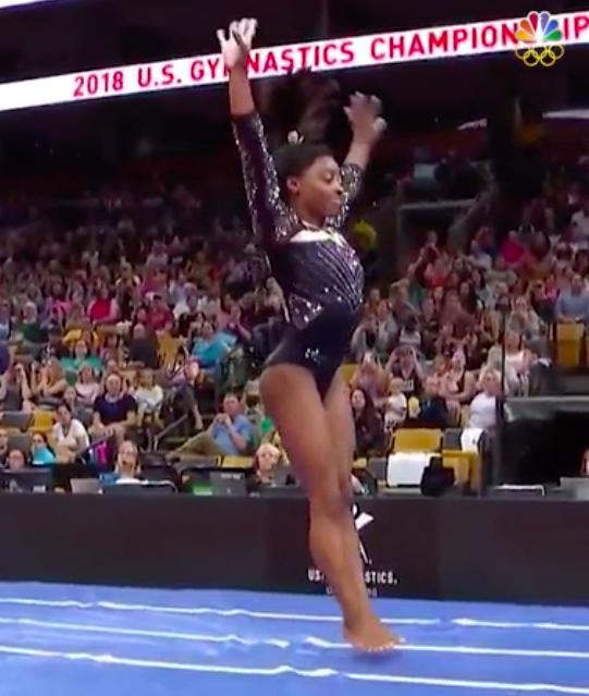 Simone Biles mid–gymnastics move