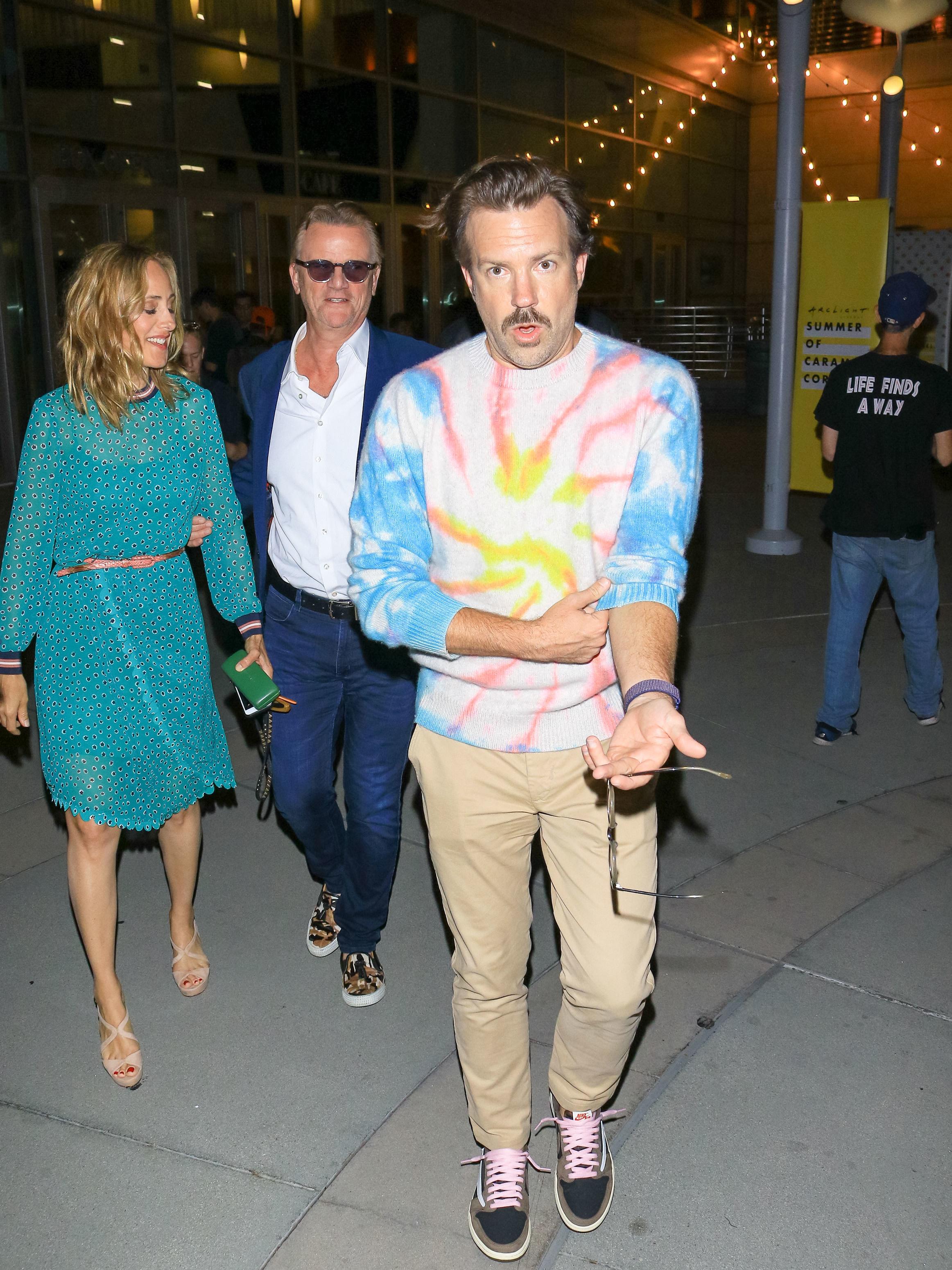 Jason walking outside in a tie-dye sweater