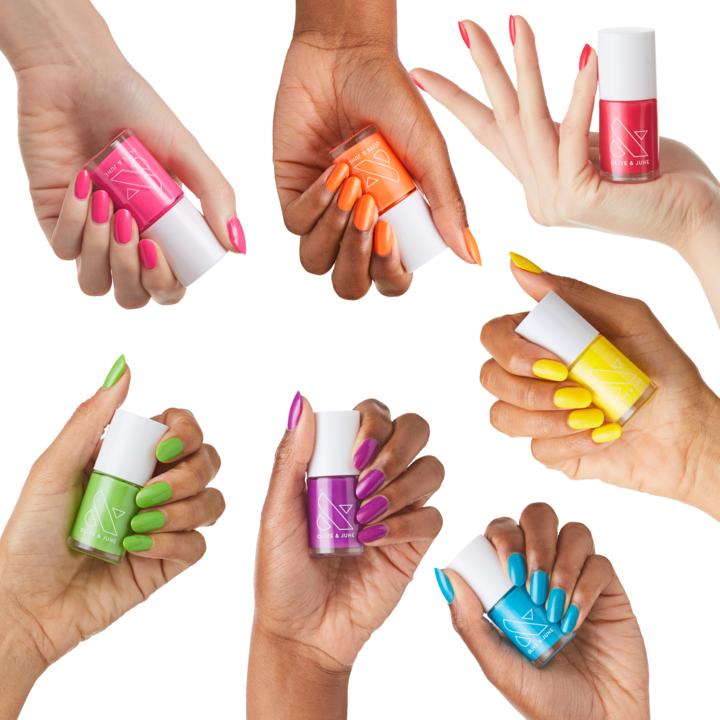 seven hands with bright nail polish and holding the nail polish tube