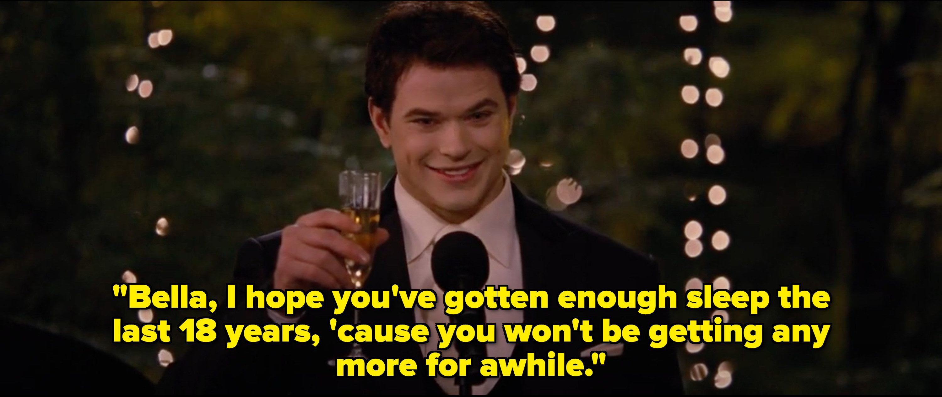 Emmett and Bella and Edward's wedding, holding up a glass to toast