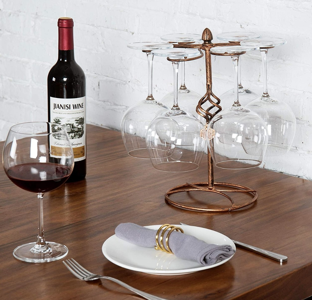 A bronze, tabletop wine glass rack that holds 6 glasses