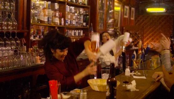 Bartending women expertly pouring drinks