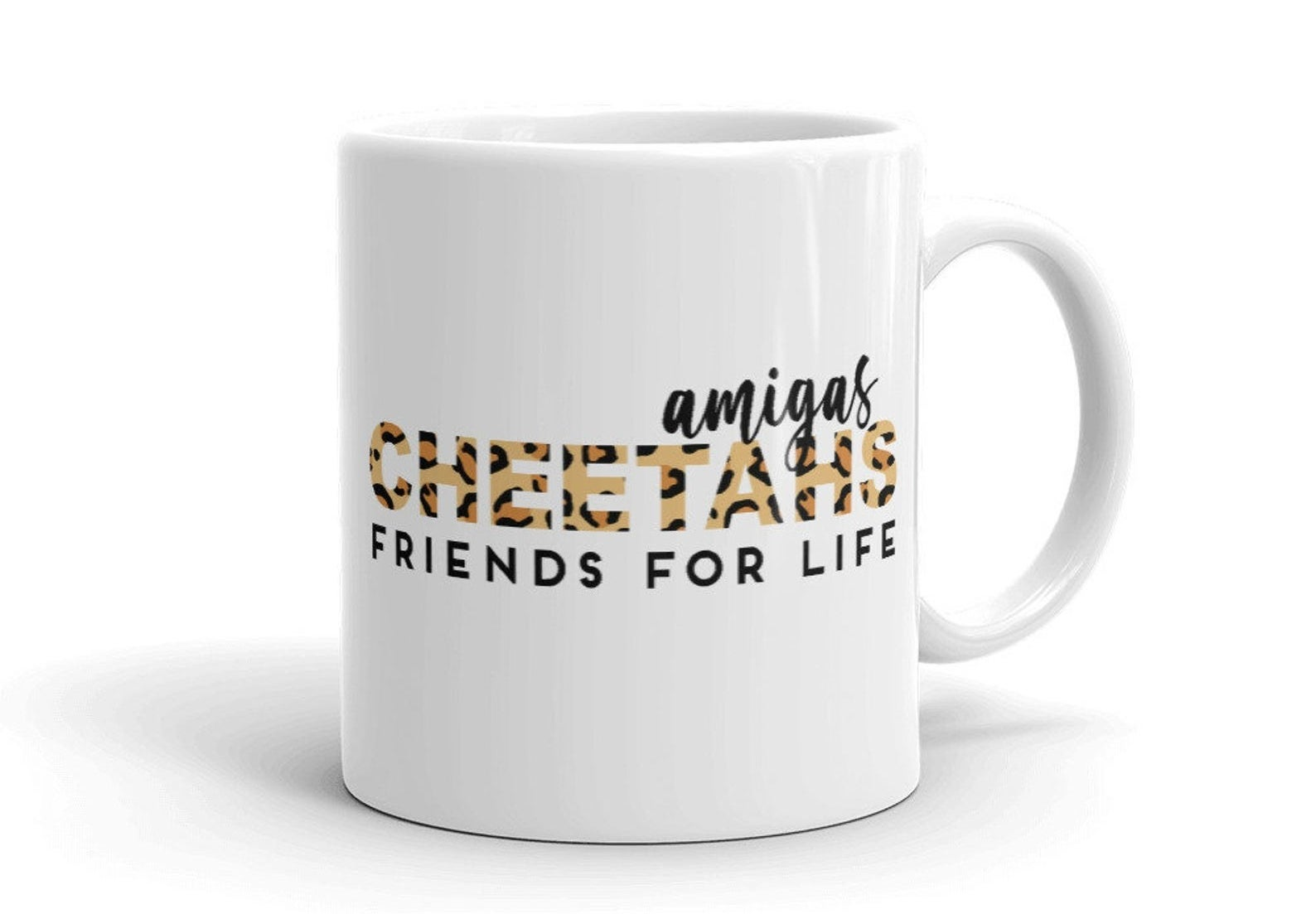 "white mug that says ""amigas cheetahs friends for life"""