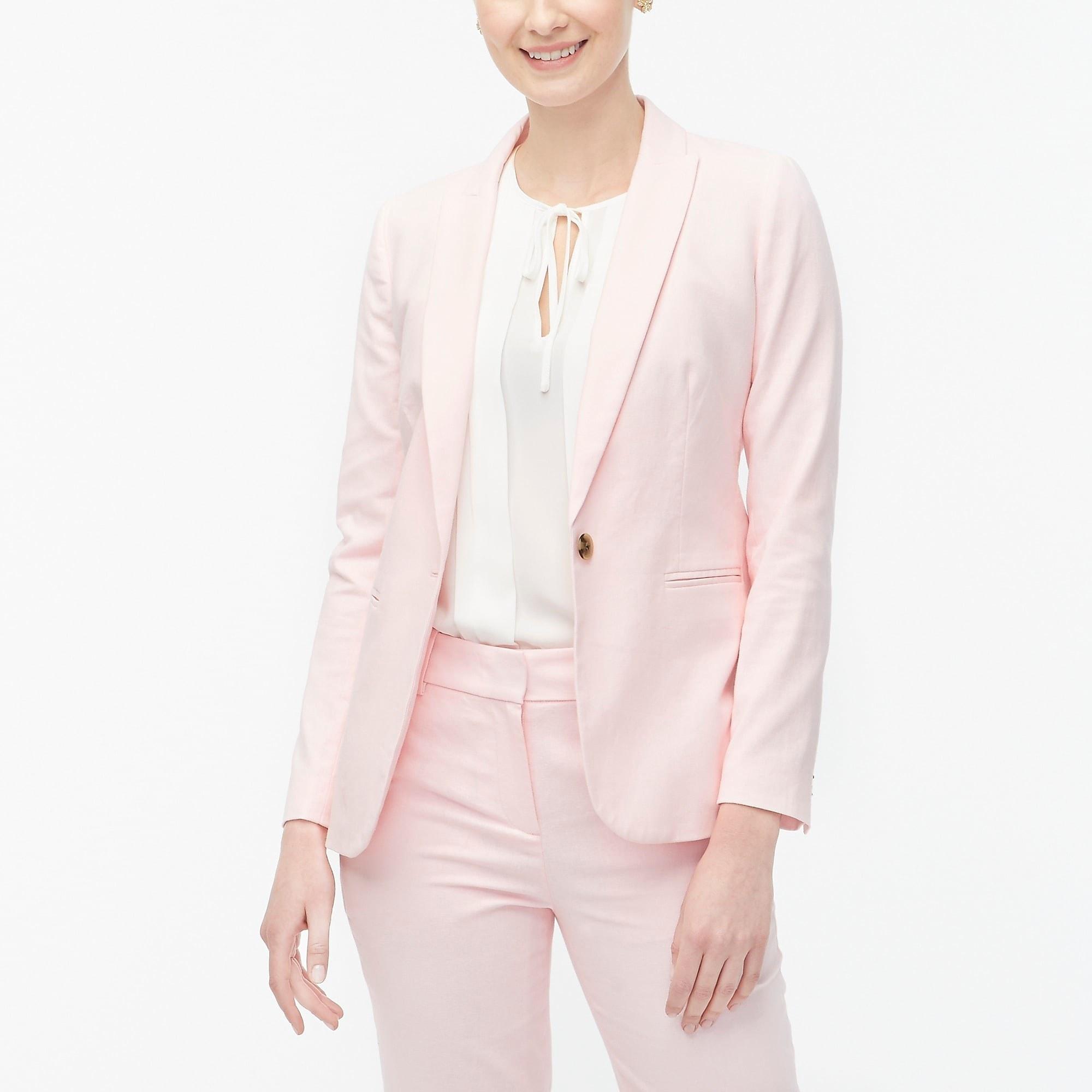 model wearing pink linen blazer