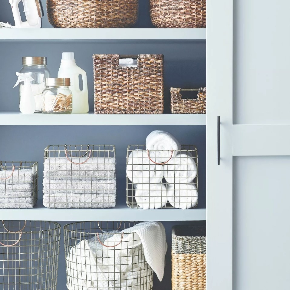 Wire crate basket holding towels in closet