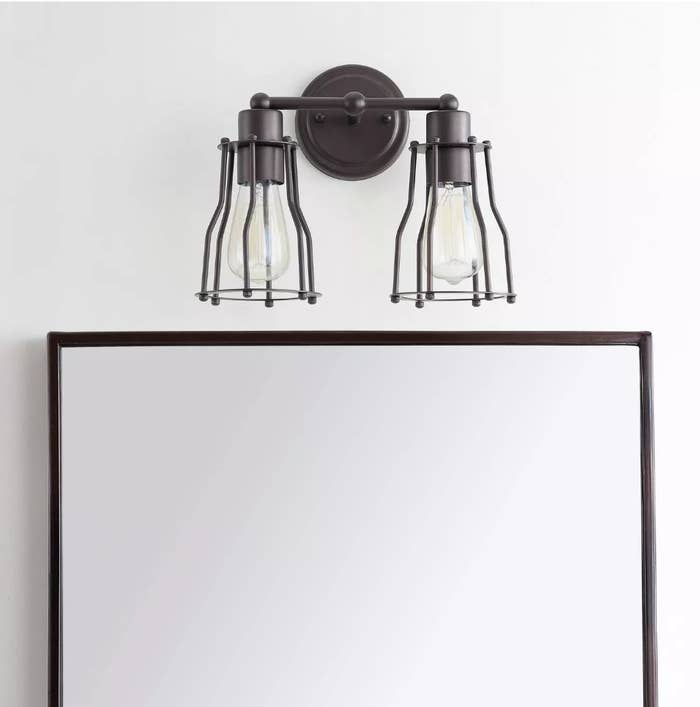 Double caged vanity light over mirror