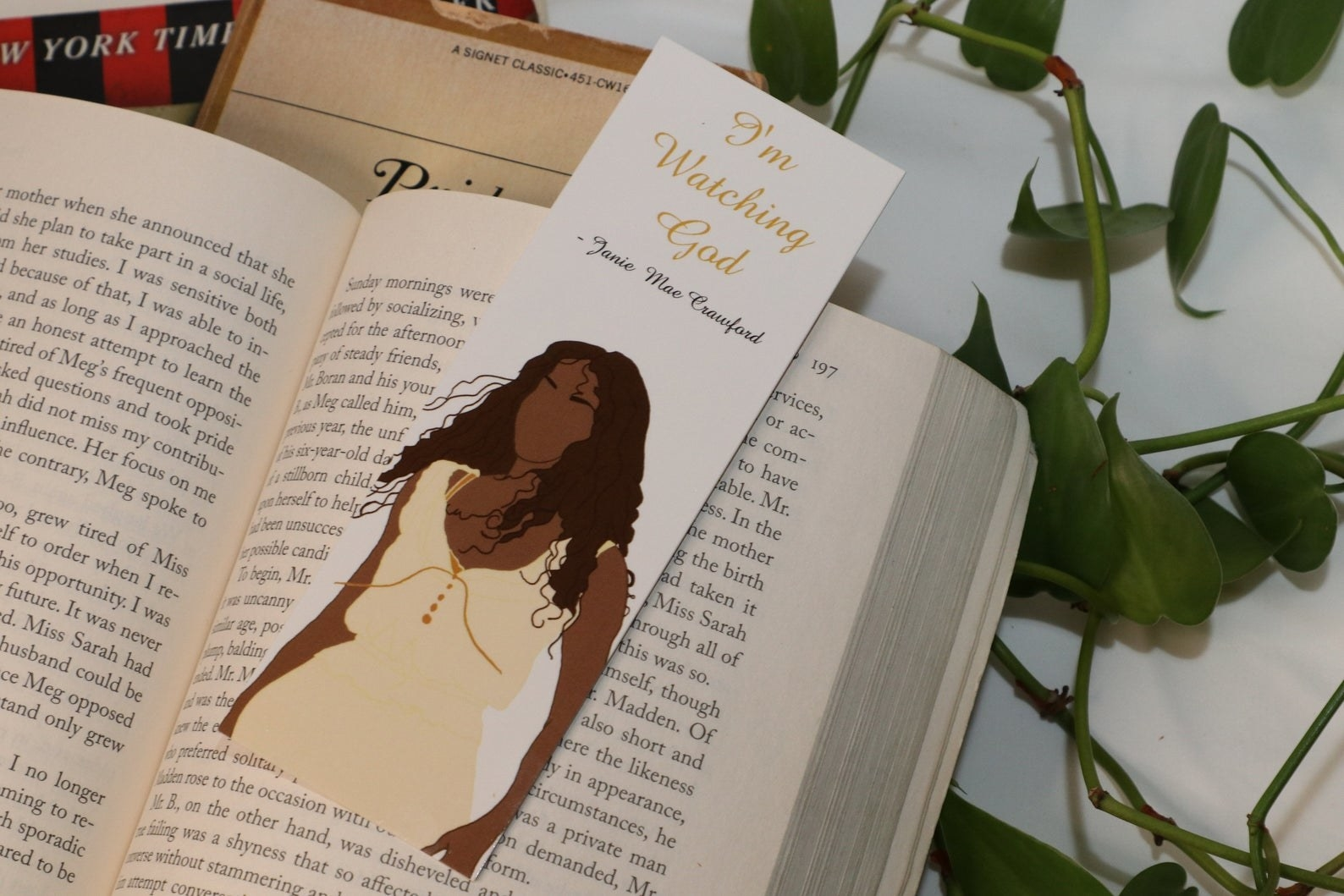 """bookmark with """"i'm watching god"""" and an illustration of Janie"""