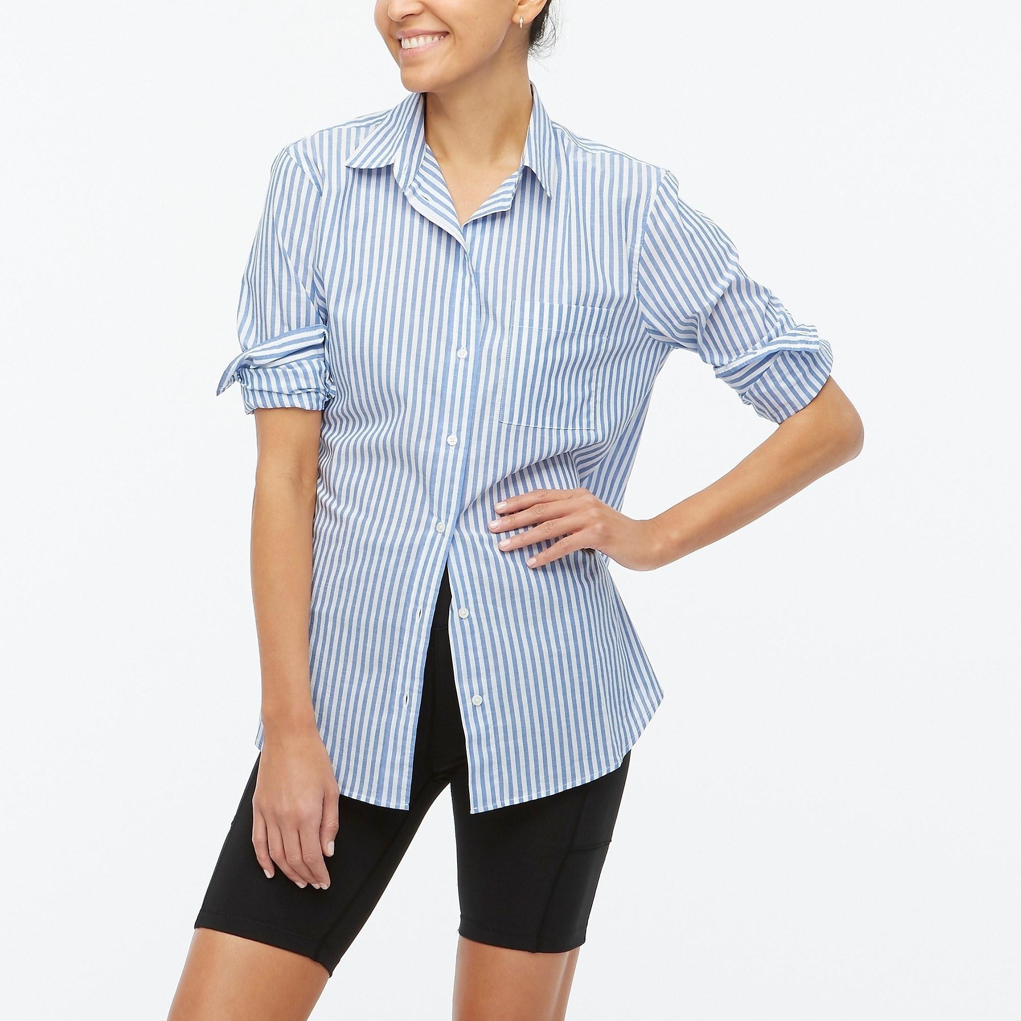 model wearing blue striped button up shirt