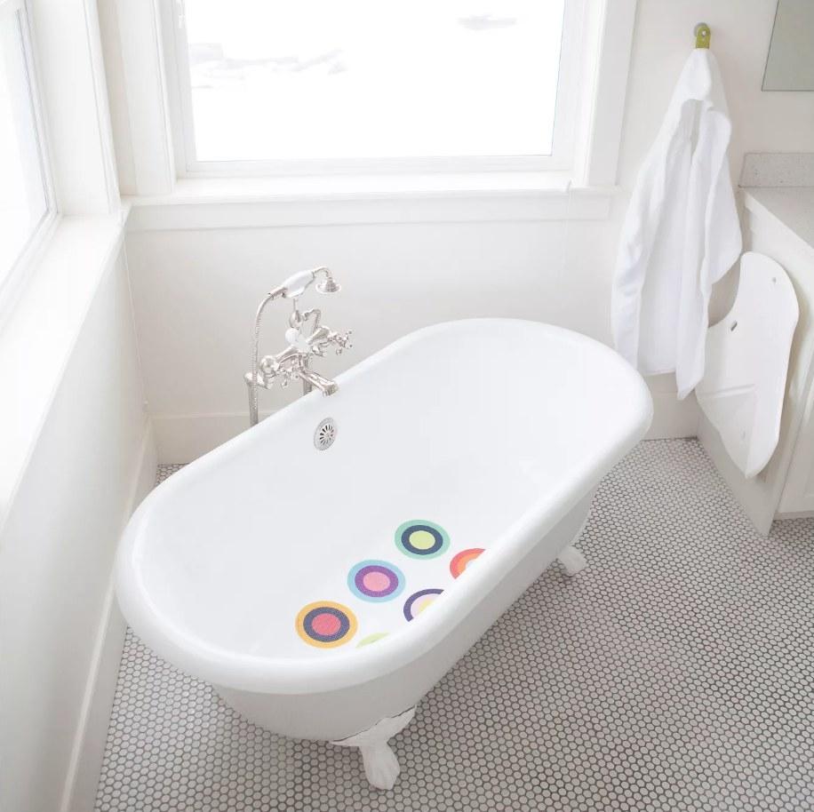 Circle rainbow bath treads in white tub