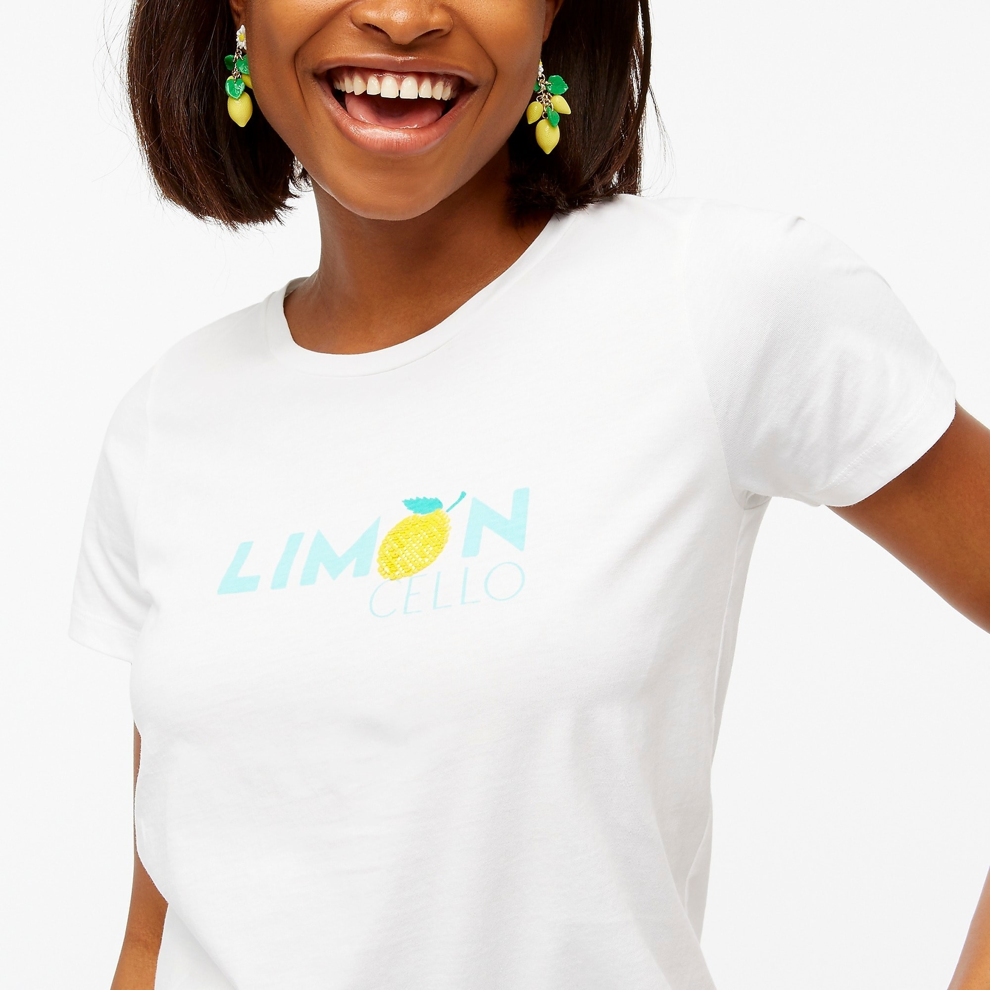 "model wearing white t-shirt that says ""limoncello"""