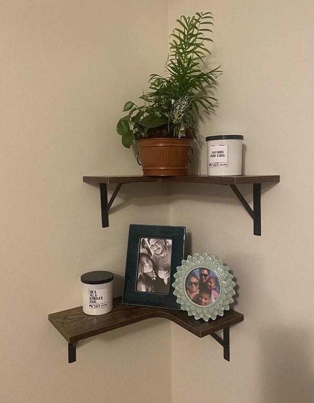 A set of rustic brown, wooden, corner floating shelves