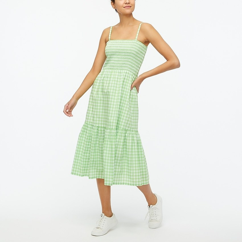 model wearing midi dress in green gingham