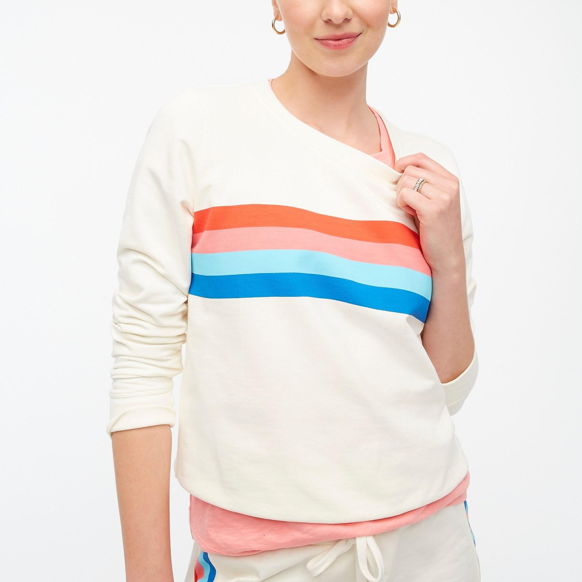 model wearing crewneck in rainbow stripe
