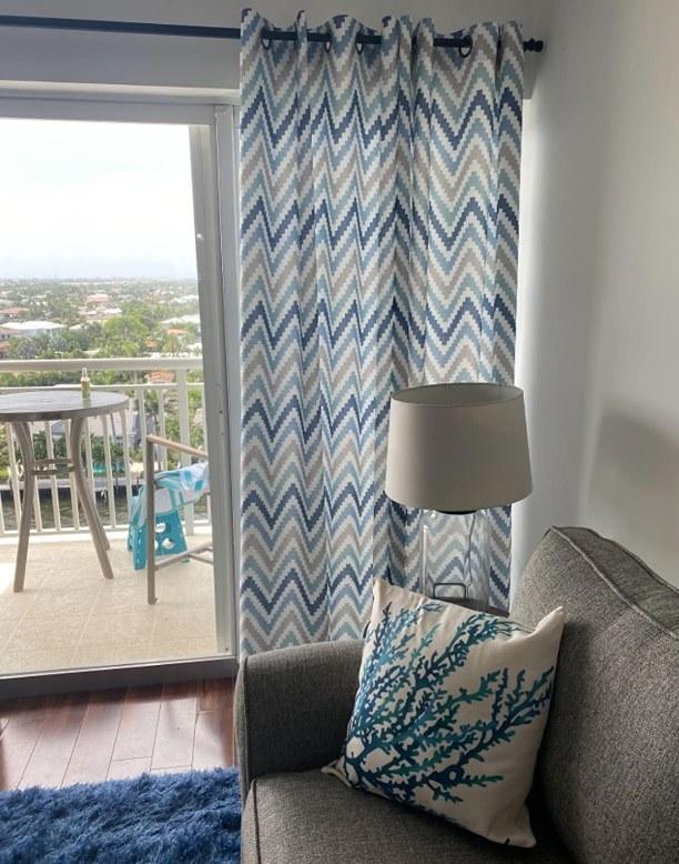 A blue/grey/white chevron living room curtain