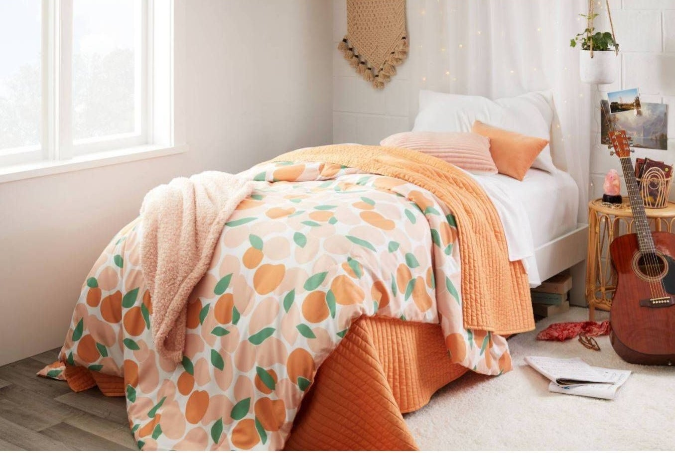 peach comforter on a twin-sized bed