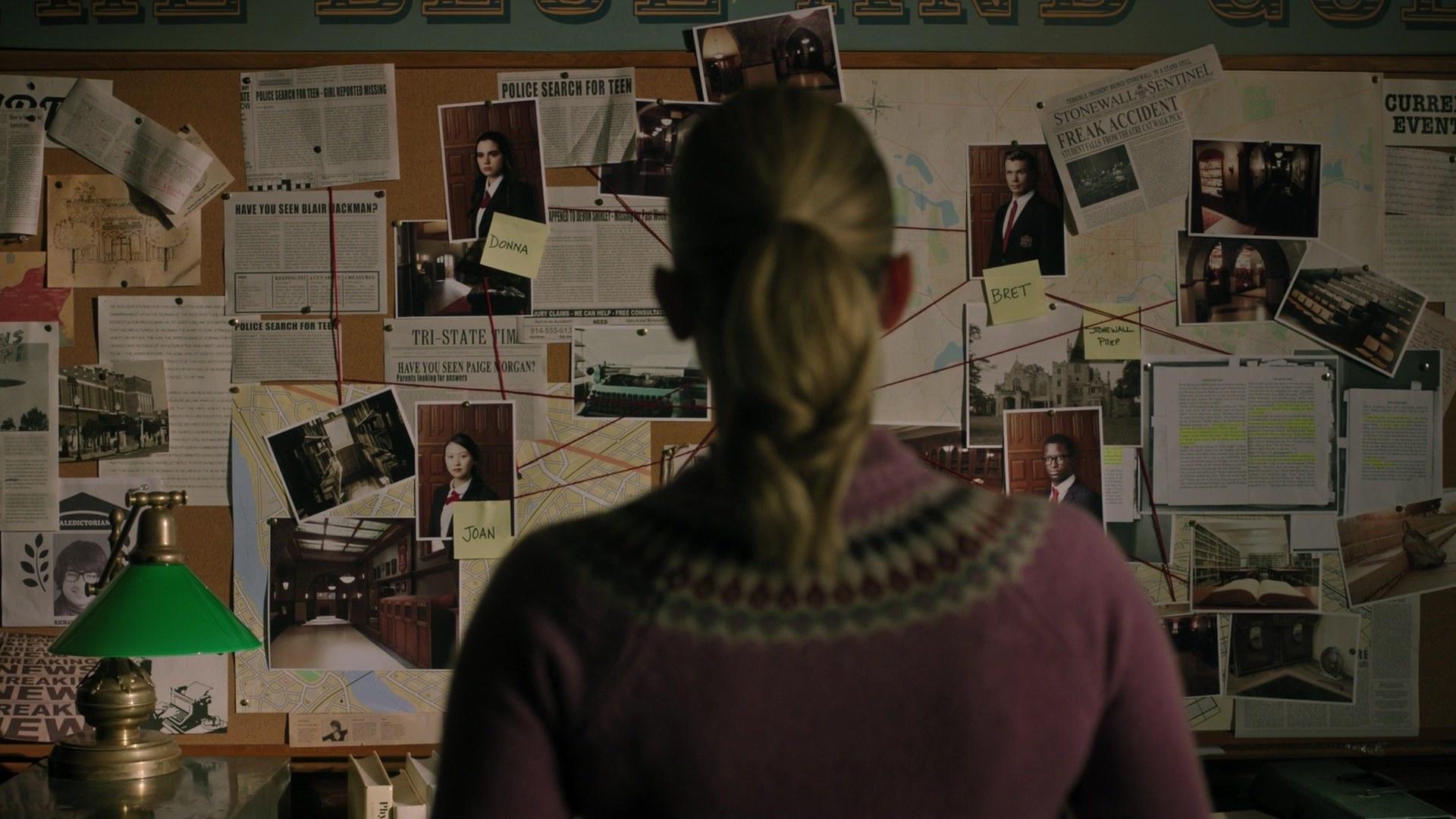 Betty admiring a murder investigation board