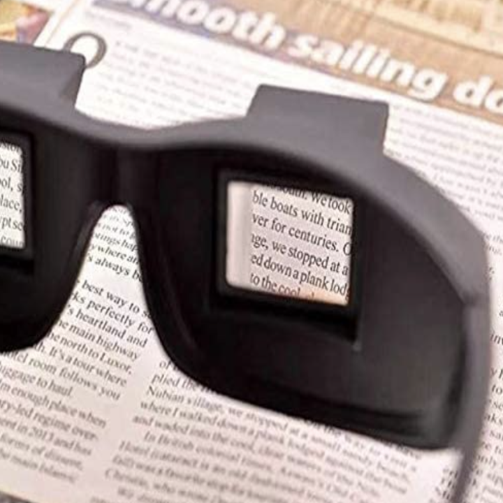 prism glasses on top of magazine