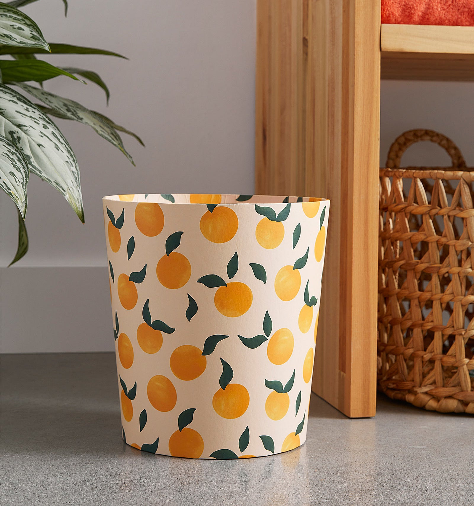 a trash can with illustrated peaches all over it