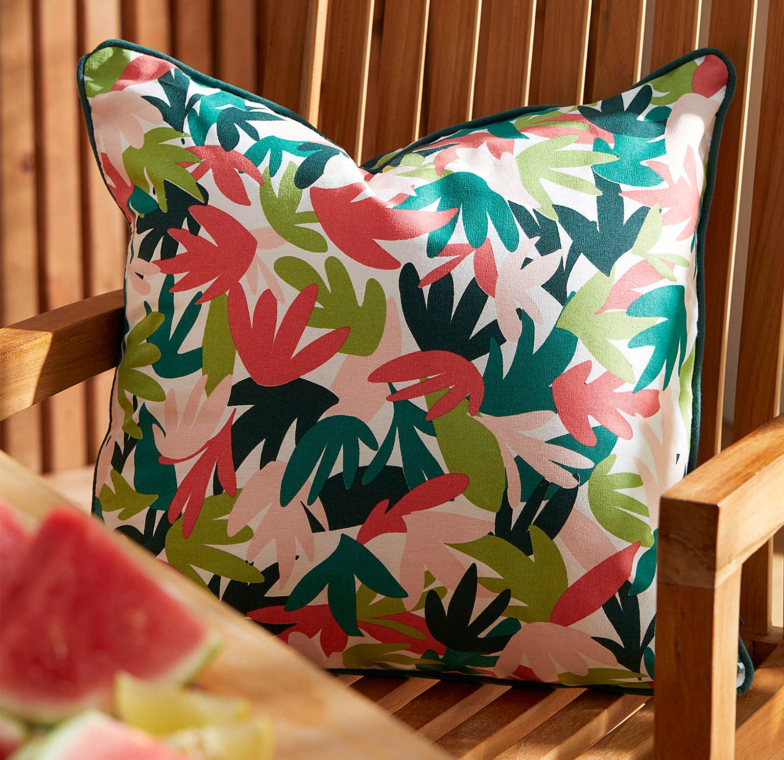 a vibrant patterned pillow on a chair