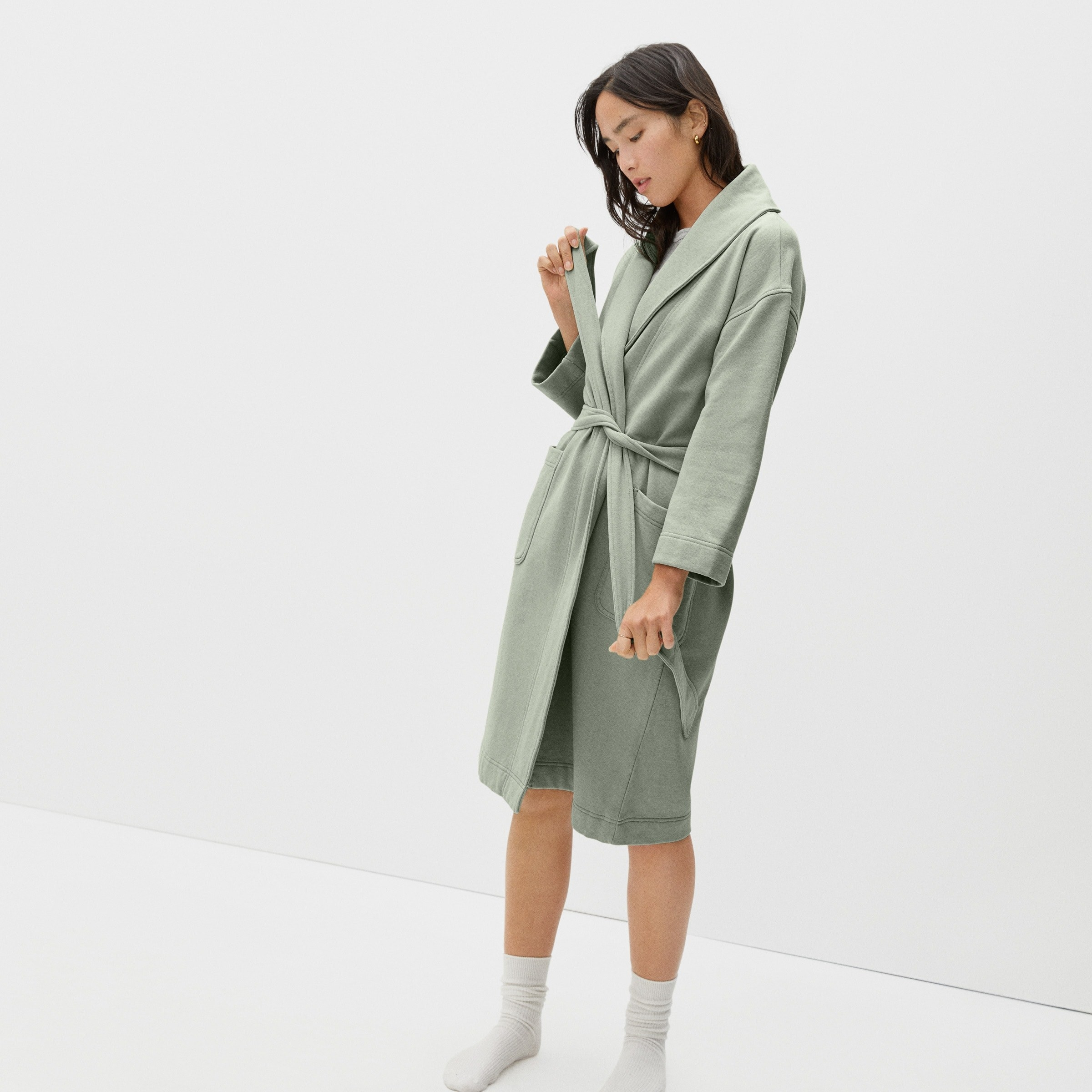 a model in a green terry robe