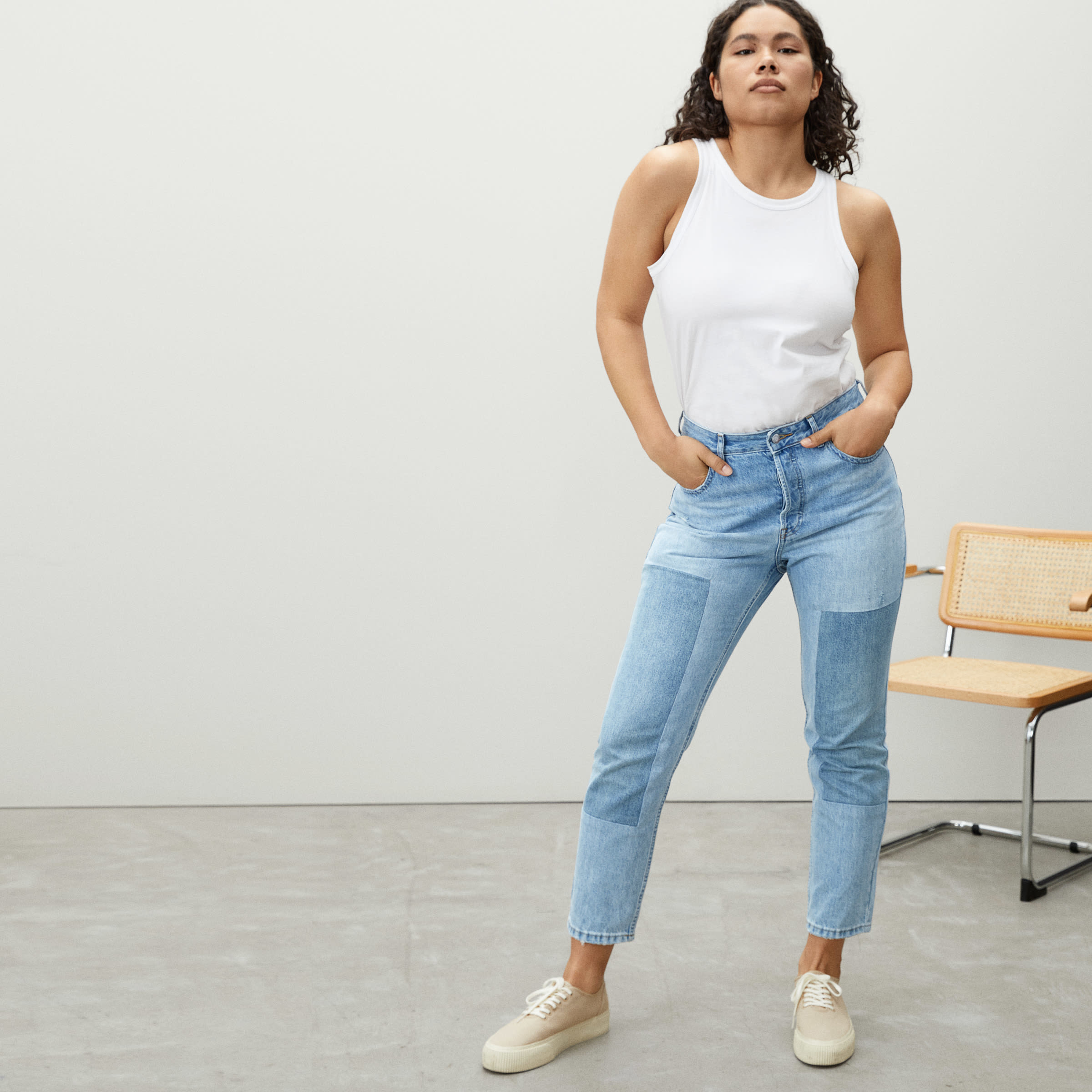 a model in blue patchy jeans