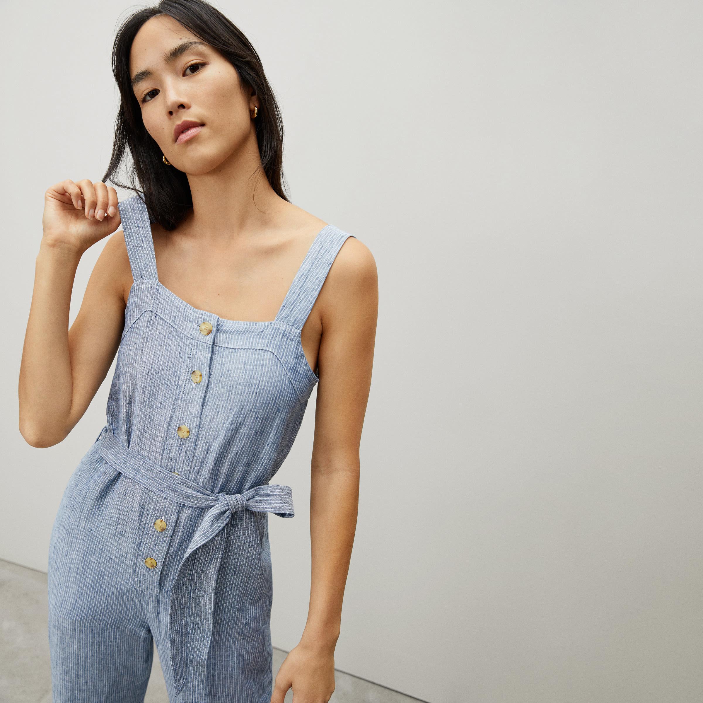 a model in blue pinstripe jumpsuit