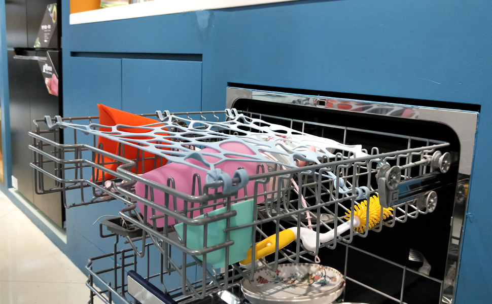 open top rack of dishwasher with net keeping stuff in place