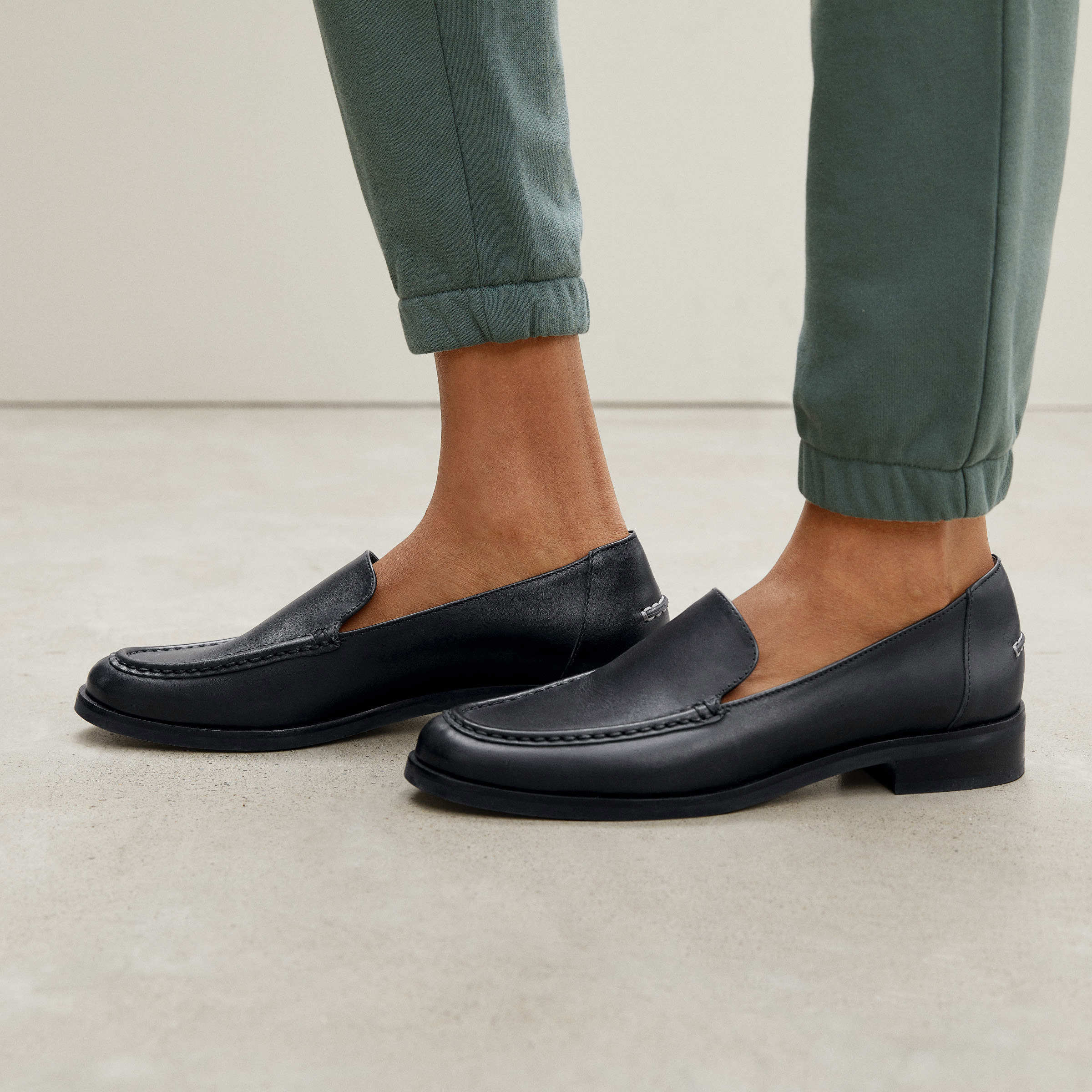 a model in black loafers