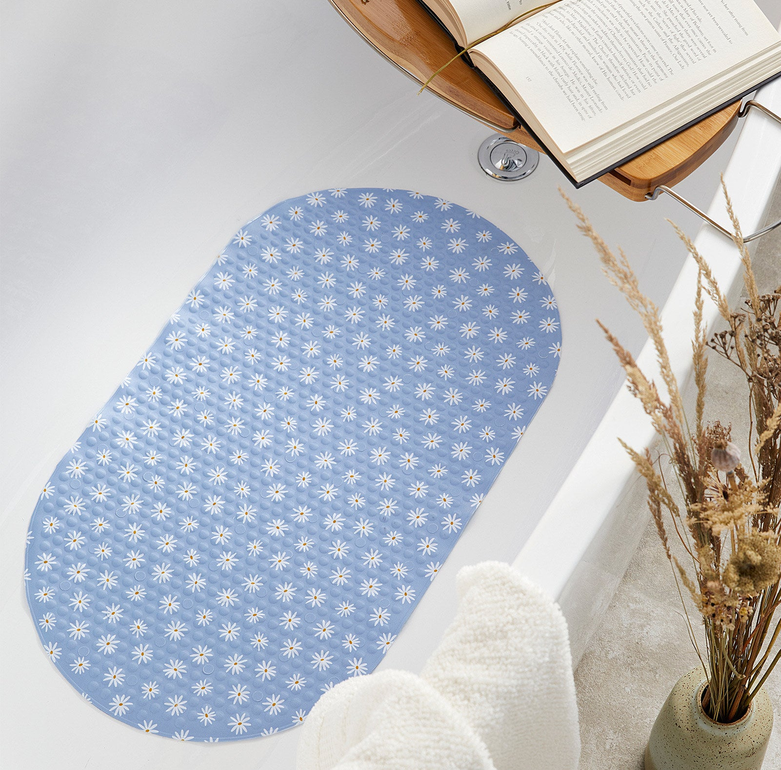 a floral bath mat in a tub