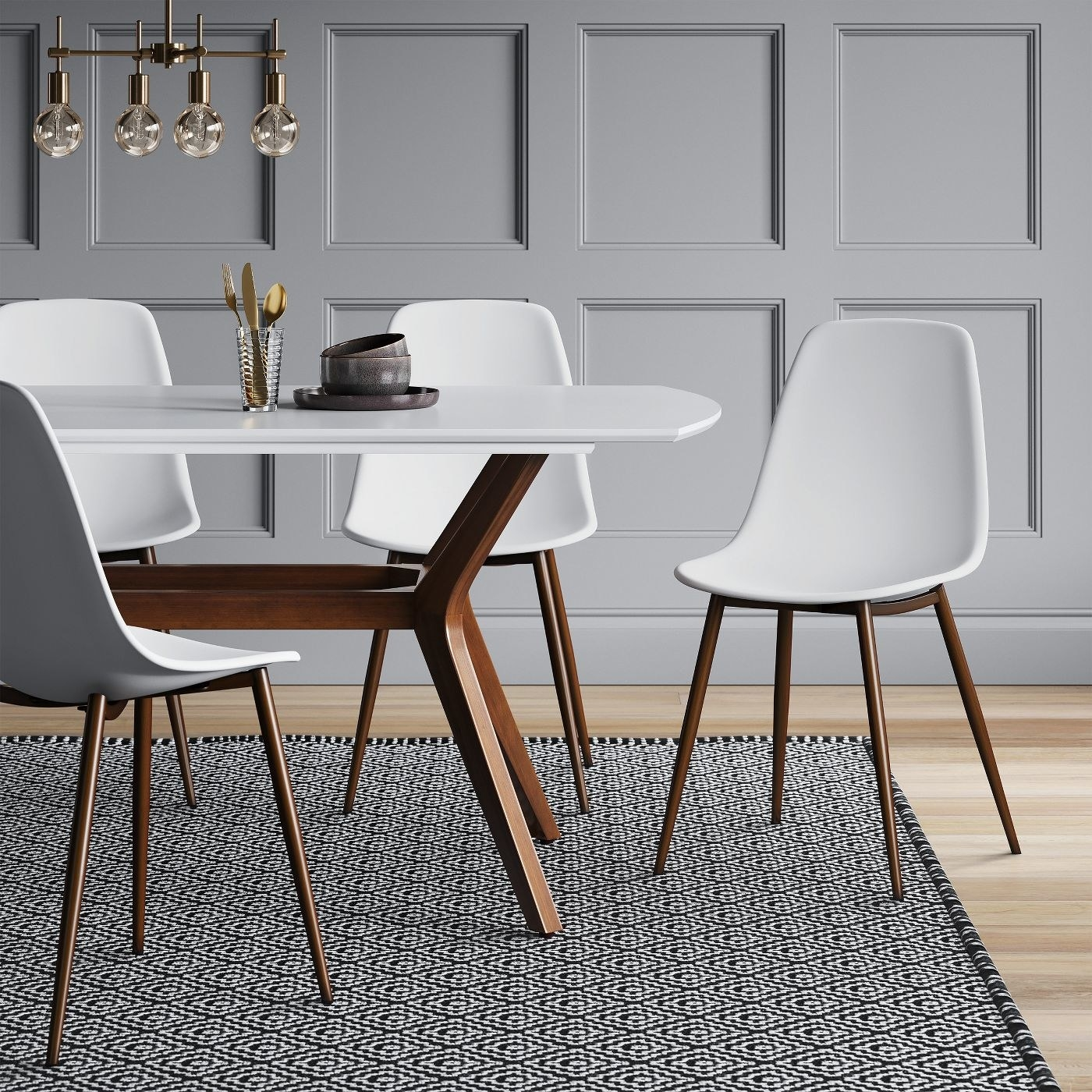 white plastic dining chairs with wooden legs next to a table