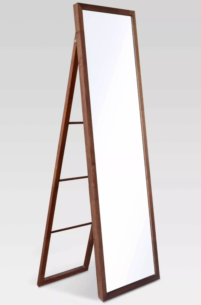 The wooden mirror with a ladder stand