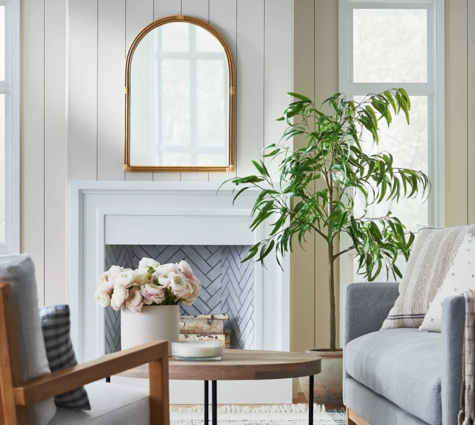 The rattan mirror on a living room wall