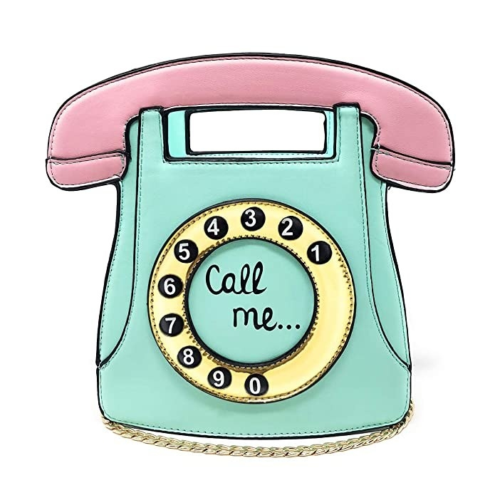A pastel teal and pink bag shaped like a vintage rotary telephone