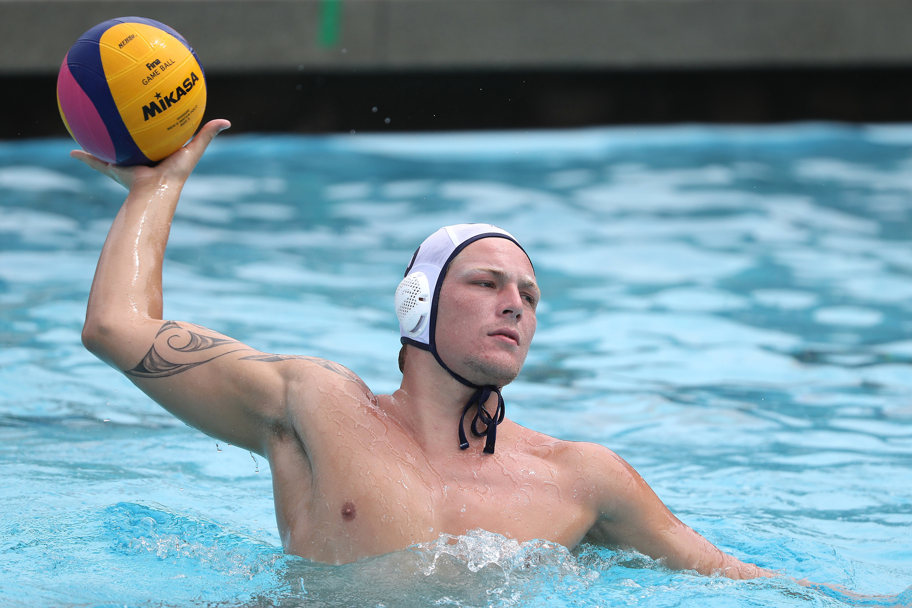 Water polo player throws ball