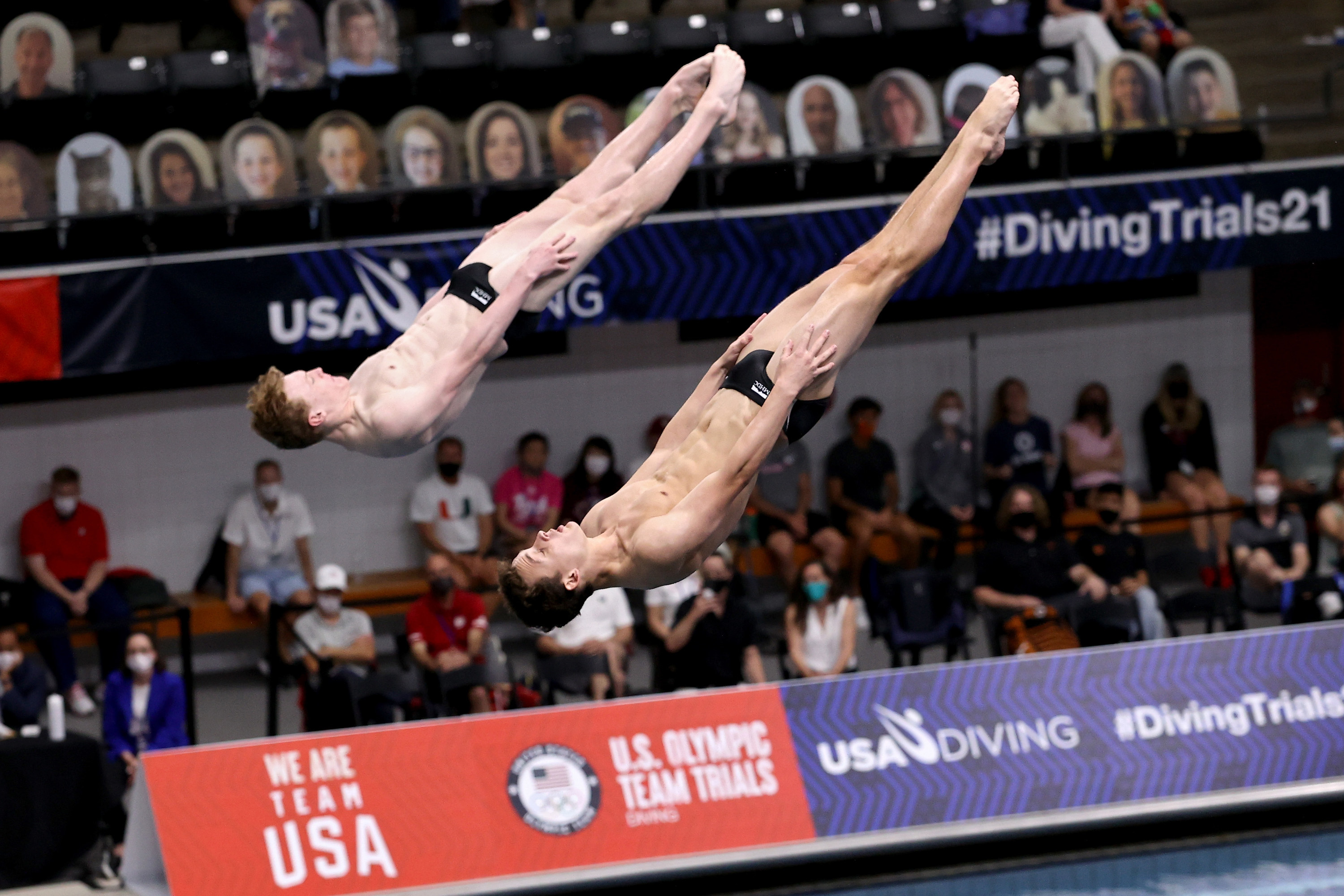 Two men diving backward and head first
