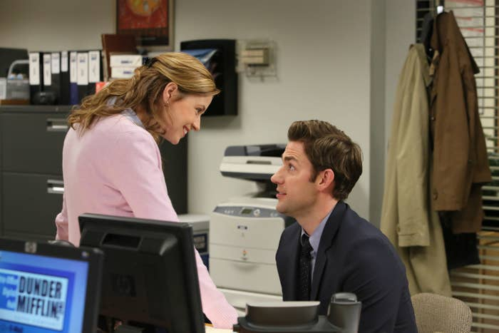 Pam looking down at Jim in the office