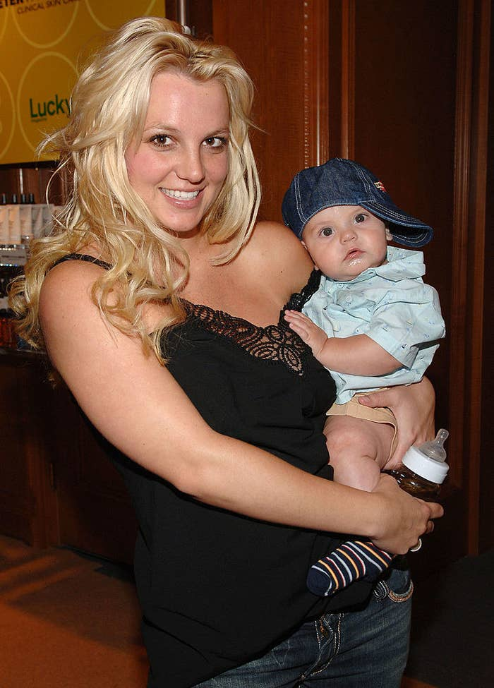 Britney holding one of her sons when he was a baby