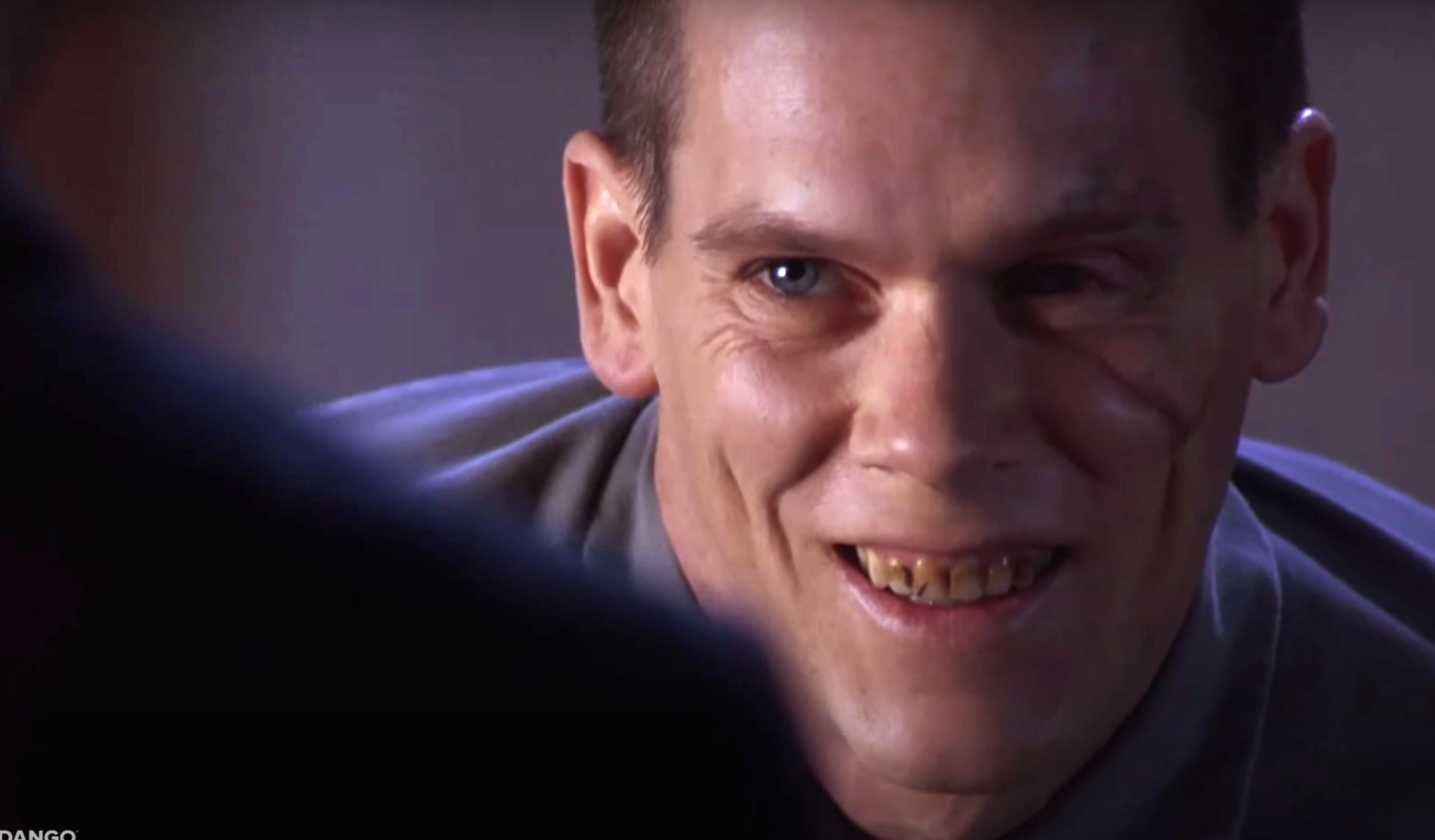 Bacon smiles as the prisoner in murder in the first with stained teeth