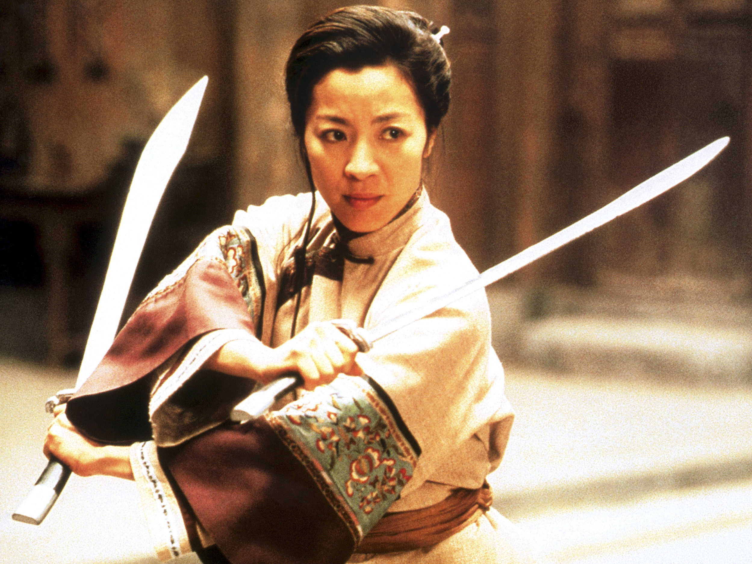 A woman holding swords in both hands