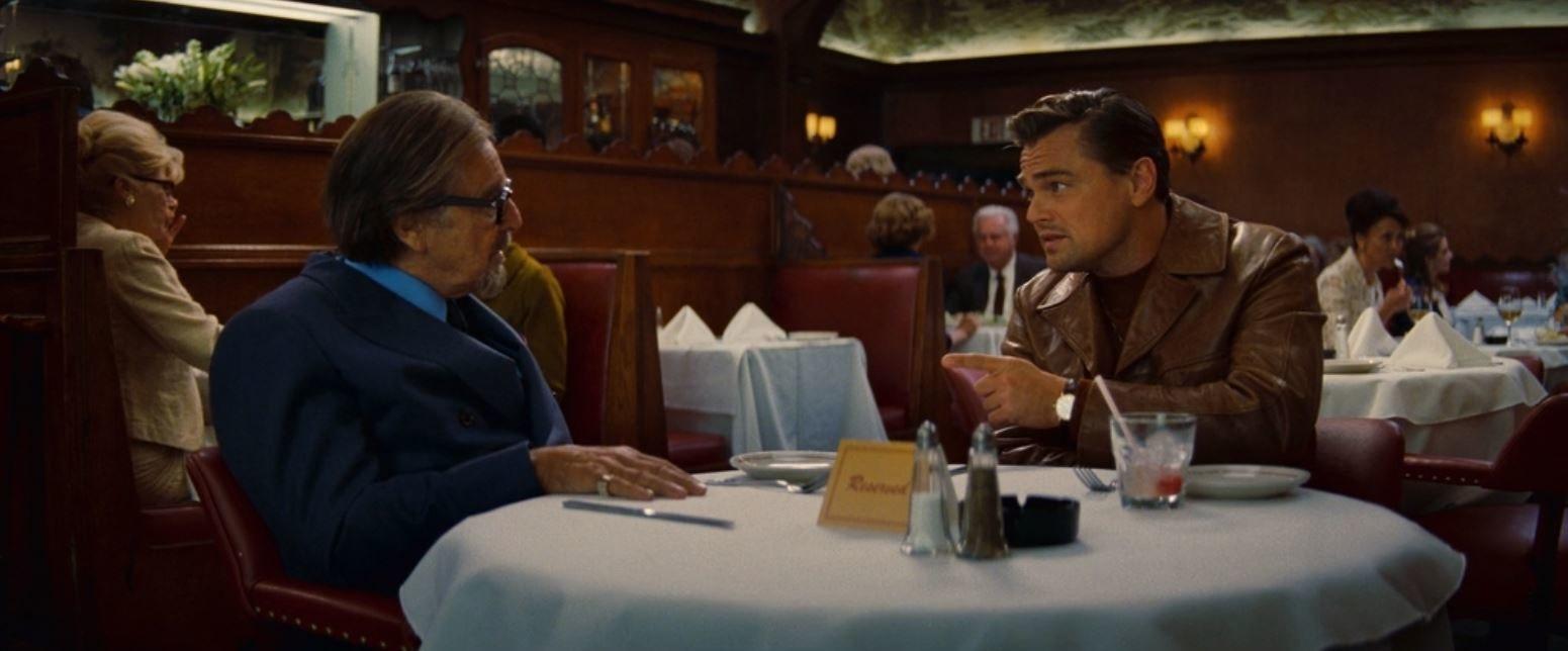 Marvin Schwarz (Al Pacino) and Rick Dalton (Leonardo DiCaprio) share a drink at the Musso & Frank Grill