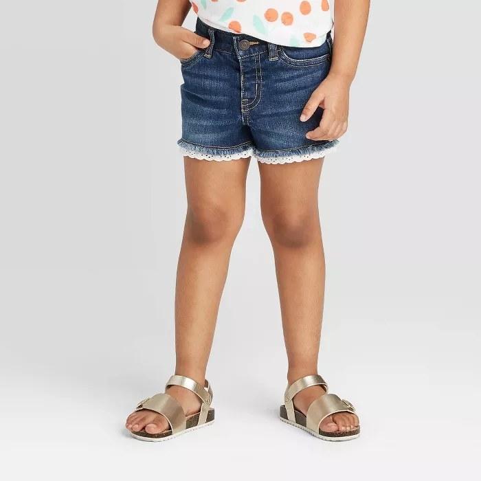 The lace hem jean shorts