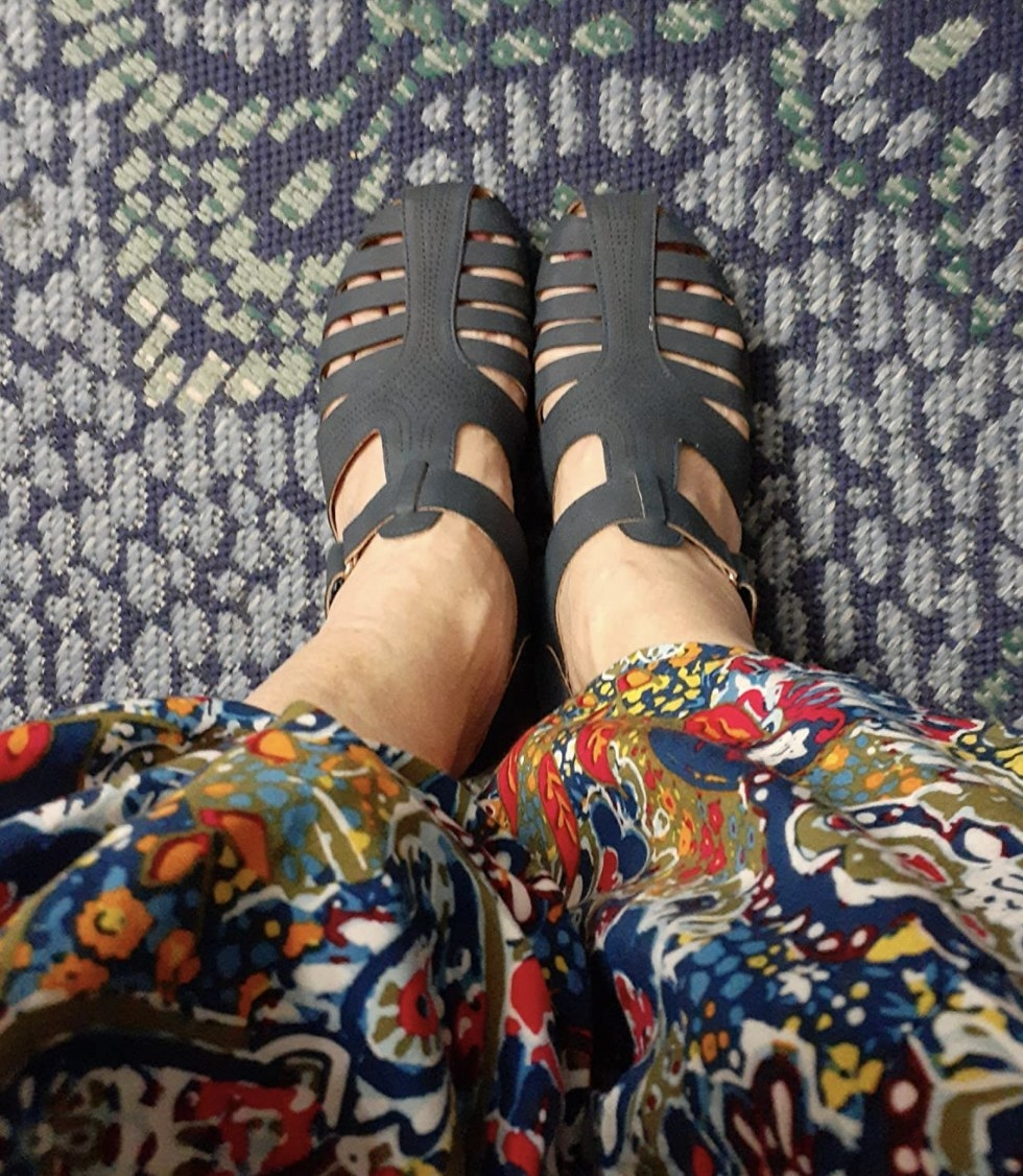 a reviewer wearing the sandals in navy