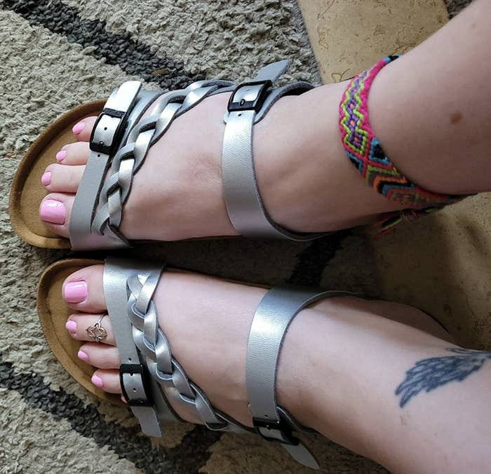 a reviewer wearing the silver braided sandals