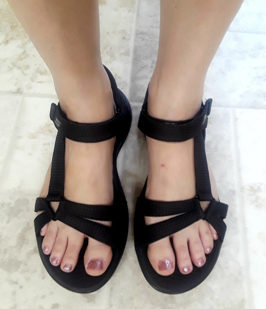 a reviewer wearing the sandals in black