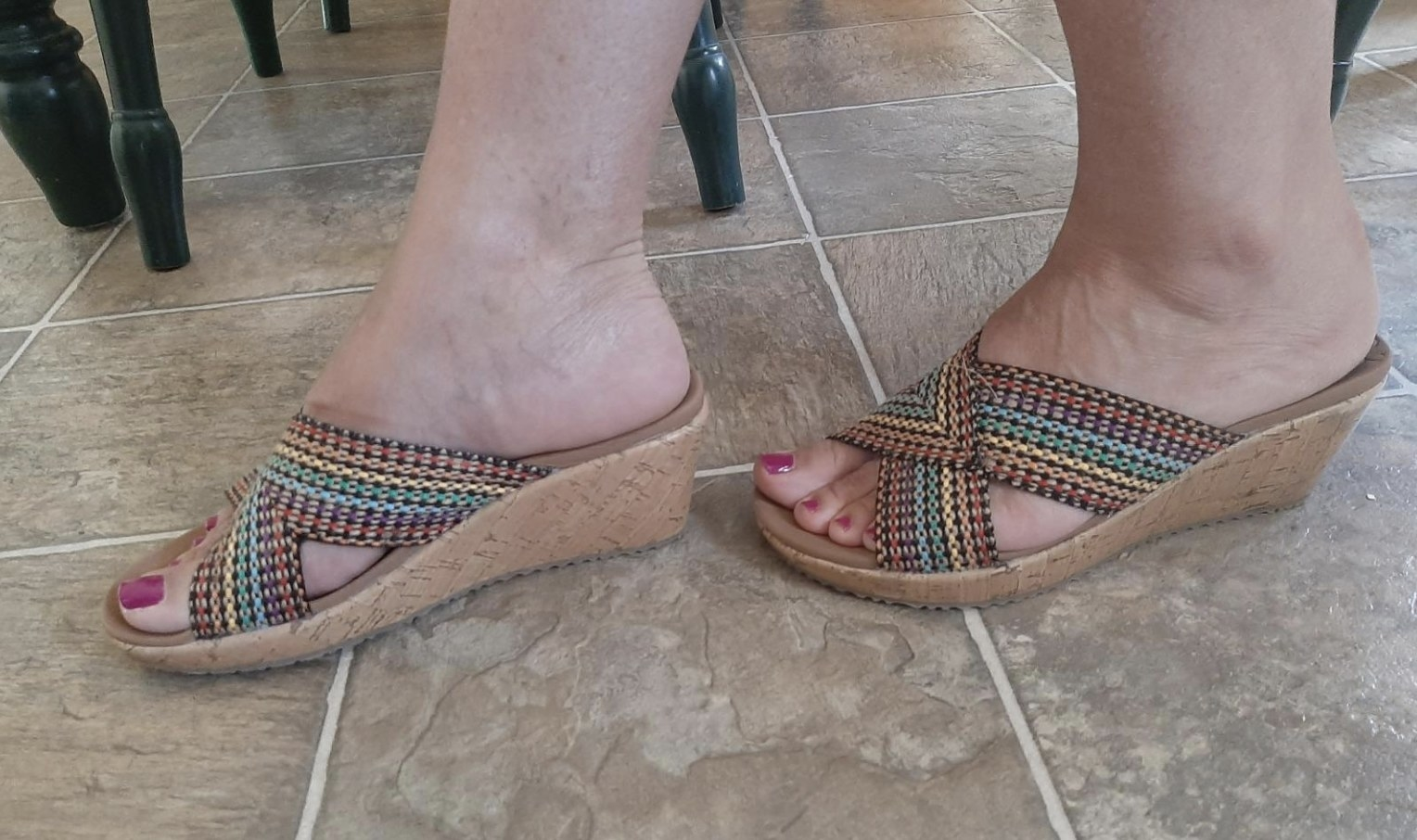 reviewer wearing the rainbow stitch wedge slip ons