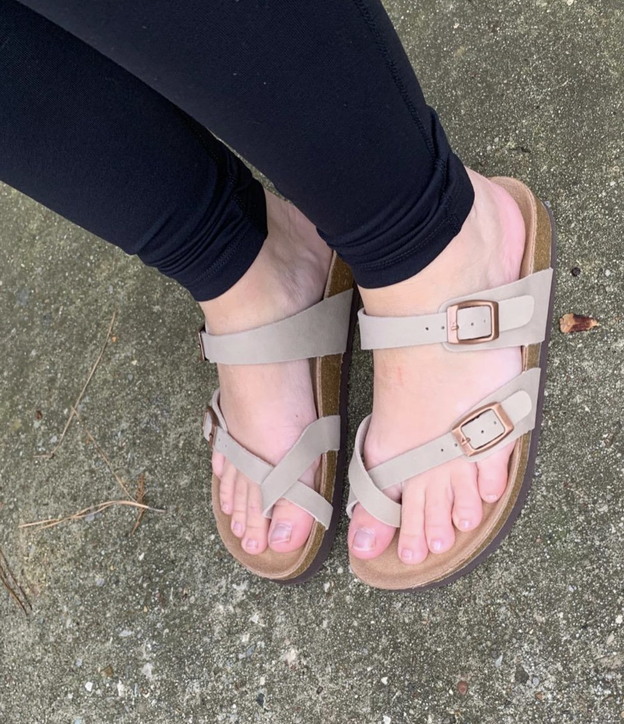 a reviewer wearing the sandals in beige