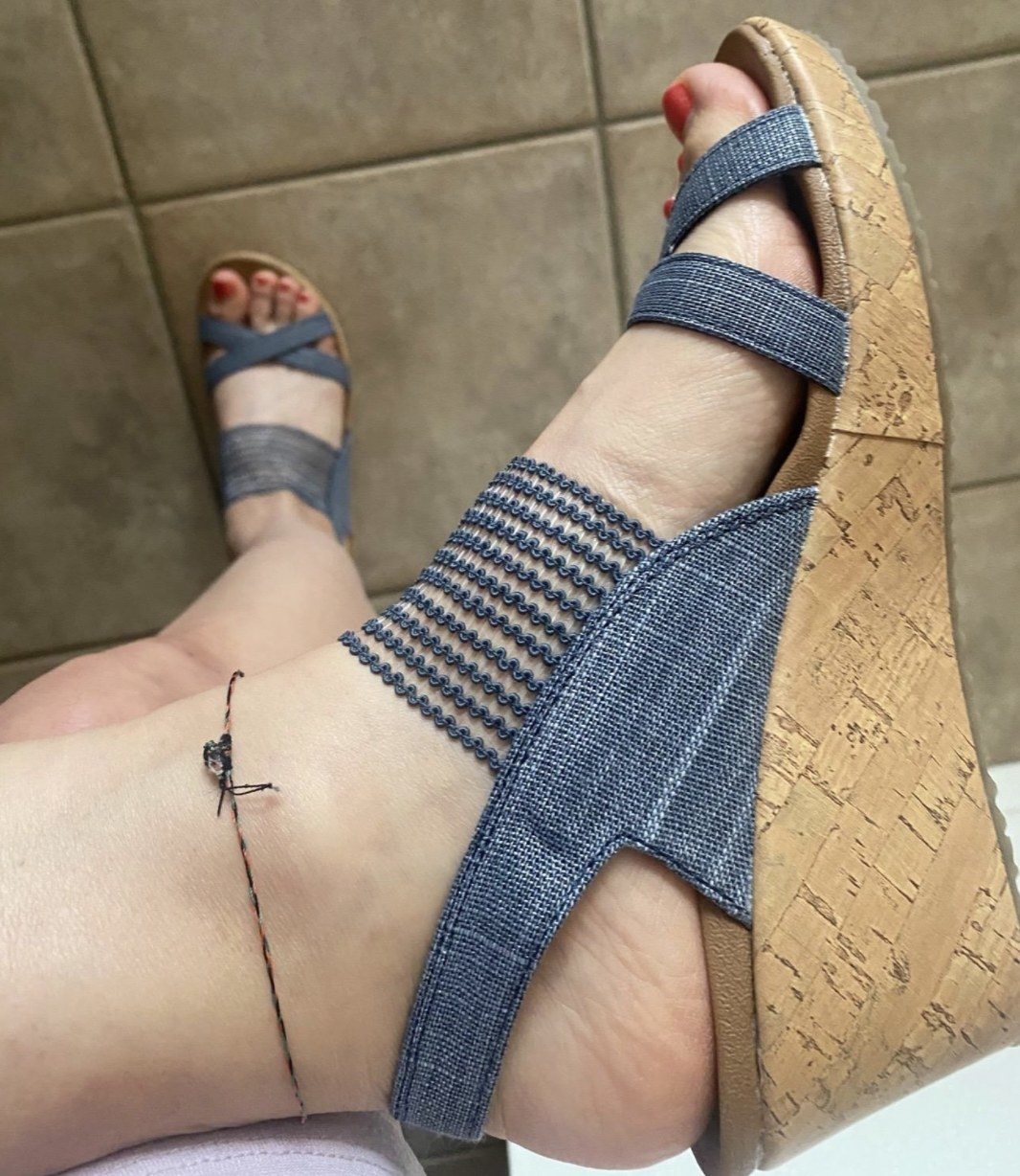 a reviewer wearing the sandals in blue