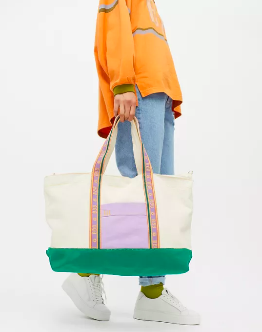 a person carrying the vibrant tote bag