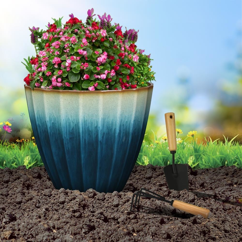 A teal resin planter